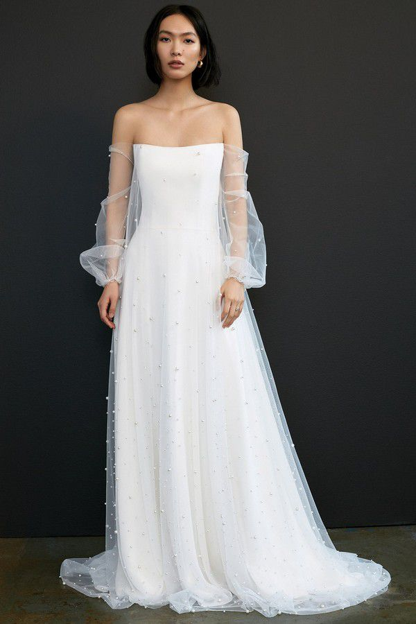 https://fashionista.com/.image/c_limit%2Ccs_srgb%2Cfl_progressive%2Ch_2000%2Cq_auto:good%2Cw_2000/MTcyMDEzNTUwODAwMjE3MjIz/savannah-miller-gayle-wedding-dress-spring-2021.jpg