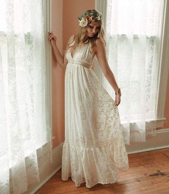 https://i.weddingomania.com/2015/03/a-boho-lace-A-line-wedding-dress-with-a-deep-neckline-no-sleeves-and-a-floral-crown-for-a-hippie-bride.jpg