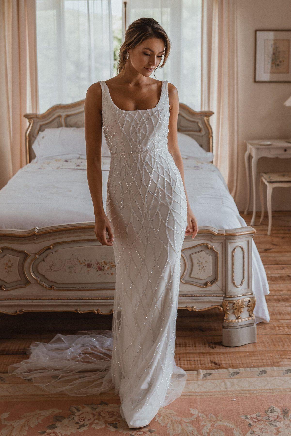 https://www.kleinfeldbridal.com/wp-content/uploads/2021/04/anna-campbell-sleeveless-square-neckline-sheath-wedding-dress-with-beading-throughout-34358762-1201x1800.jpg
