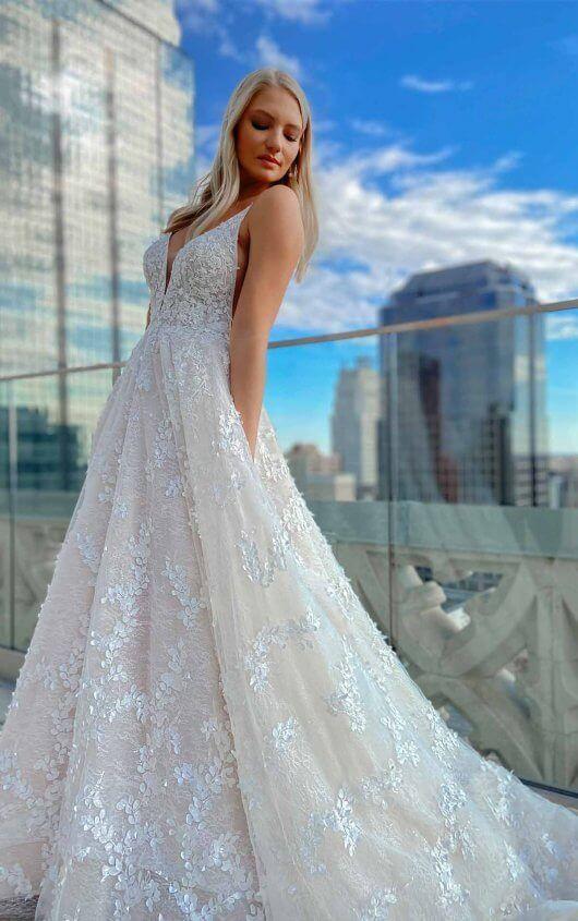 https://www.kleinfeldbridal.com/wp-content/uploads/2021/01/martina-liana-backless-romantic-a-line-wedding-dress-with-3d-floral-detail-34331033.jpg