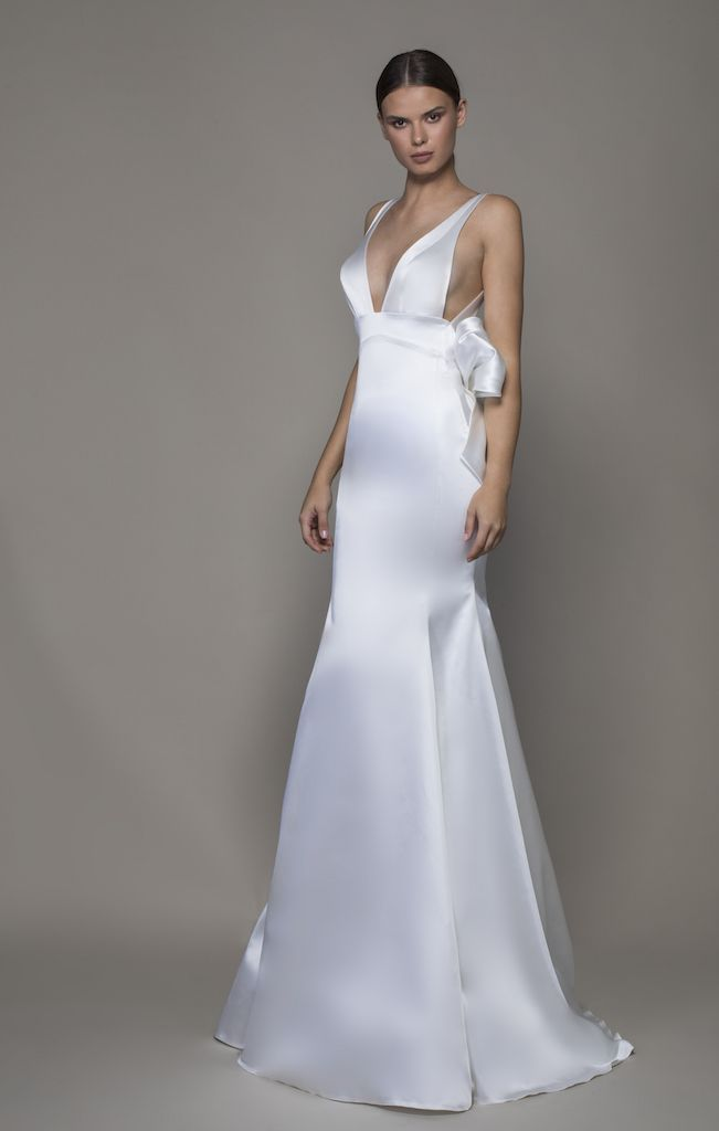 https://www.kleinfeldbridal.com/wp-content/uploads/2019/10/pnina-tornai-sleeveless-v-neckline-satin-sheath-wedding-dress-with-asymmetrical-back-8000016.jpg
