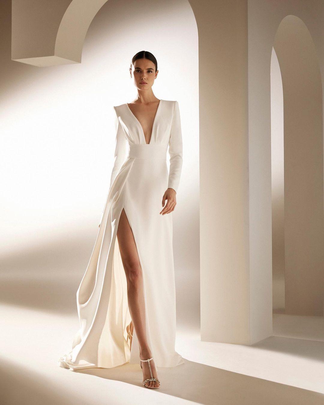 https://www.kleinfeldbridal.com/wp-content/uploads/2020/10/pronovias-long-sleeved-a-line-wedding-dress-with-v-neckline-34312108.jpg