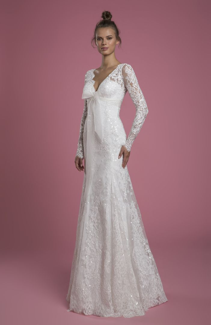 https://www.kleinfeldbridal.com/wp-content/uploads/2021/04/p-by-pnina-tornai-long-sleeve-v-neck-lace-fit-and-flare-sequin-embroidered-wedding-dress-with-bow-30000020.jpg