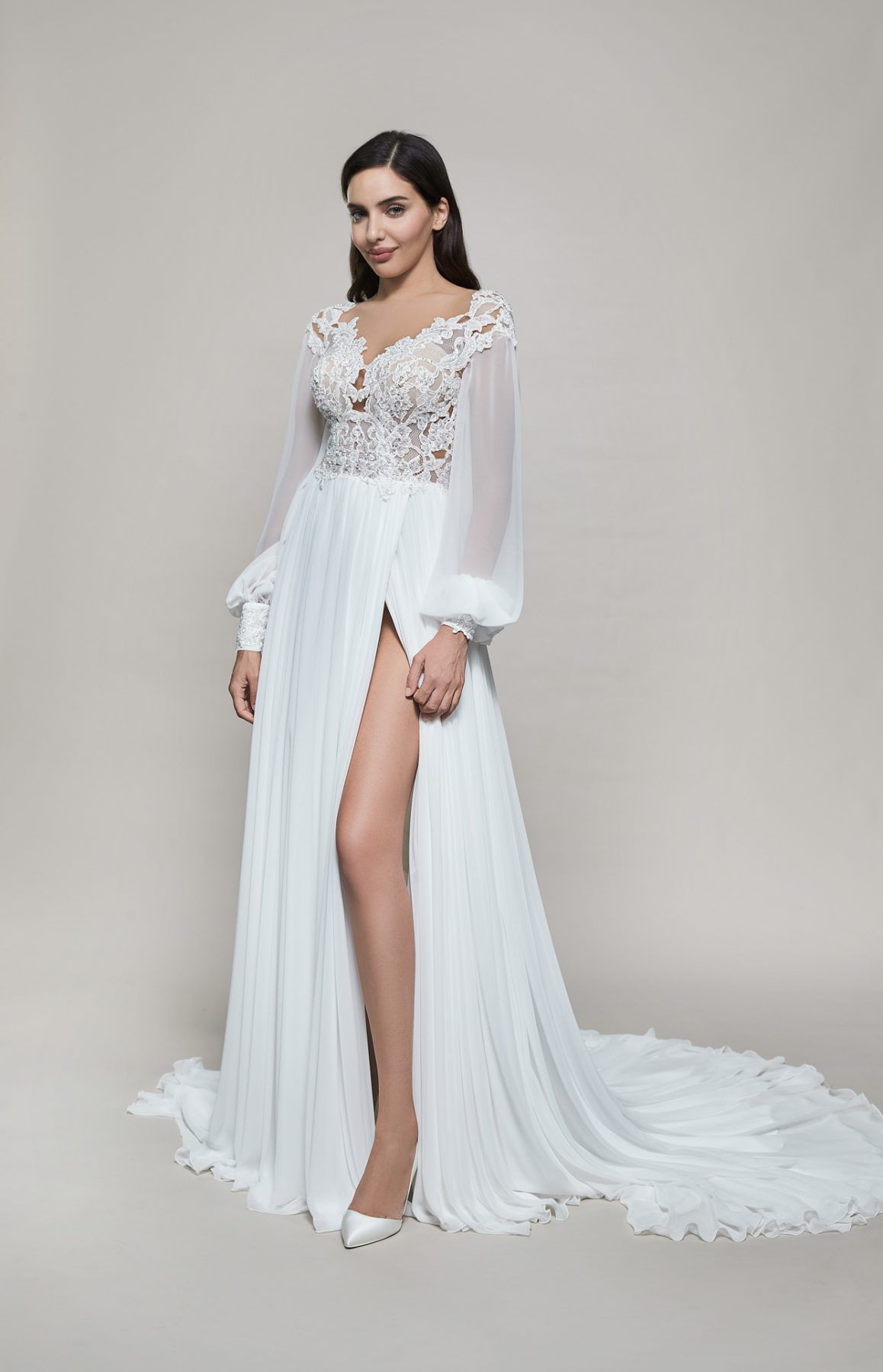 https://www.kleinfeldbridal.com/wp-content/uploads/2020/11/maison-signore-long-sleeve-v-neckline-a-line-wedding-dress-with-slit-34284240-1-1158x1800.jpg