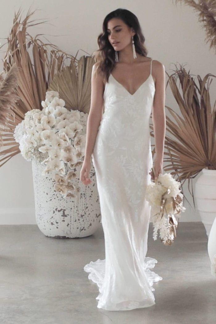https://media.graceloveslace.com/20201027183611/grace-loves-lace.shop_.wedding-dresses.video_.loyola_001-700x1050.jpg