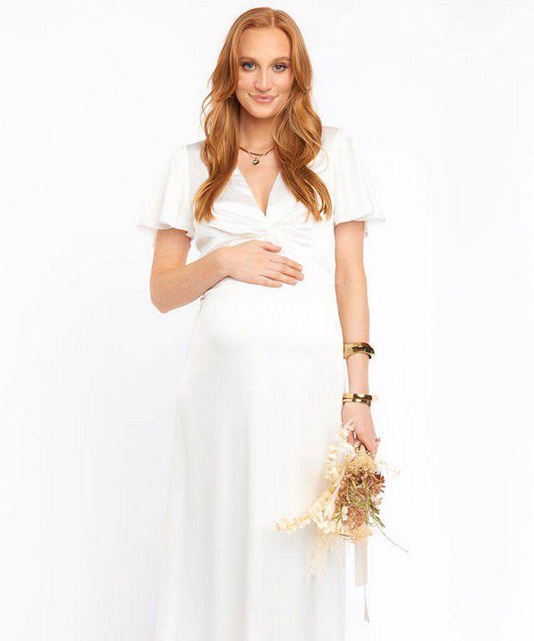 https://images.ctfassets.net/6m9bd13t776q/2ZaJ5VWxLYYvXD5jj61Q3g/6f07d081ae1d9818f7fdb6cb9e36bc7b/show-me-your-mumu-rome-maternity-wedding-dress-750x900.jpg?q=75