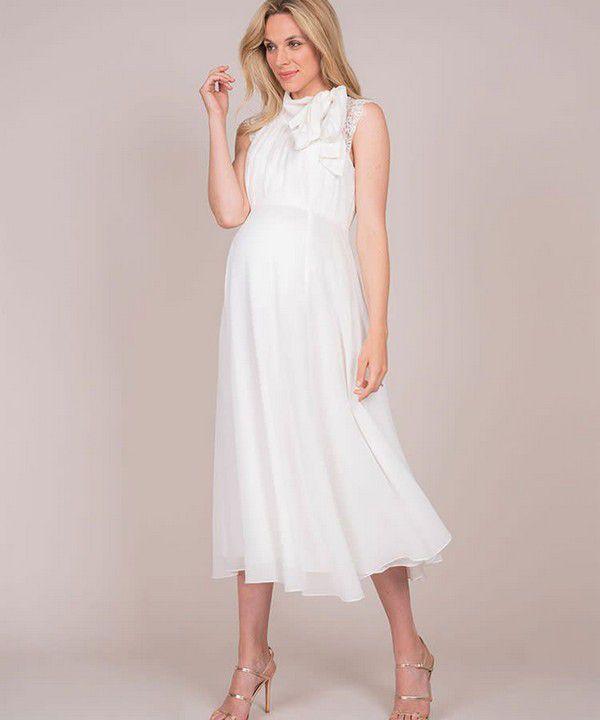 https://images.ctfassets.net/6m9bd13t776q/5Y8aYGwZpydmcapUwvtmJO/5a26a1056ff91a68ec3c7ebff2265299/seraphine-greta-maternity-wedding-dress-750x900.jpg?q=75