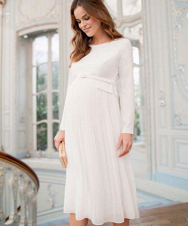 https://images.ctfassets.net/6m9bd13t776q/3xOAGf1cBdEVcvrVxXdIr9/f7e557211429ef33ea1fbd9b104e7a03/seraphine-josephina-ivory-pleated-maternity-wedding-dress-750x900.jpg?q=75