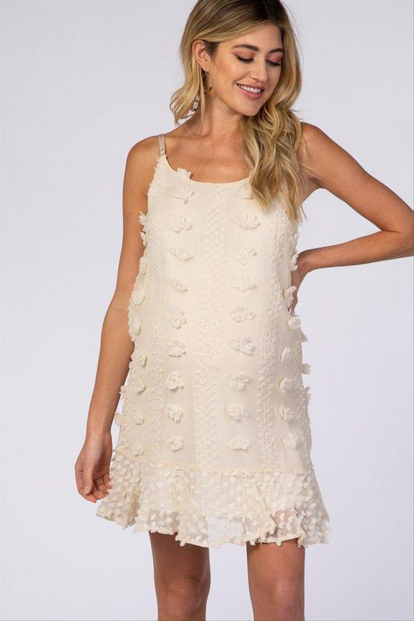 https://cdn0.hitched.co.uk/articles/images/6/5/0/0/img_90056/maternity-wedding-dress-pom-poms.jpg
