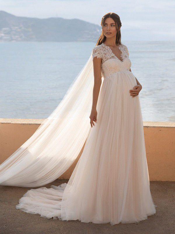 https://cdn0.hitched.co.uk/articles/images/4/7/9/9/img_89974/maternity-wedding-dress-pronovias.jpg