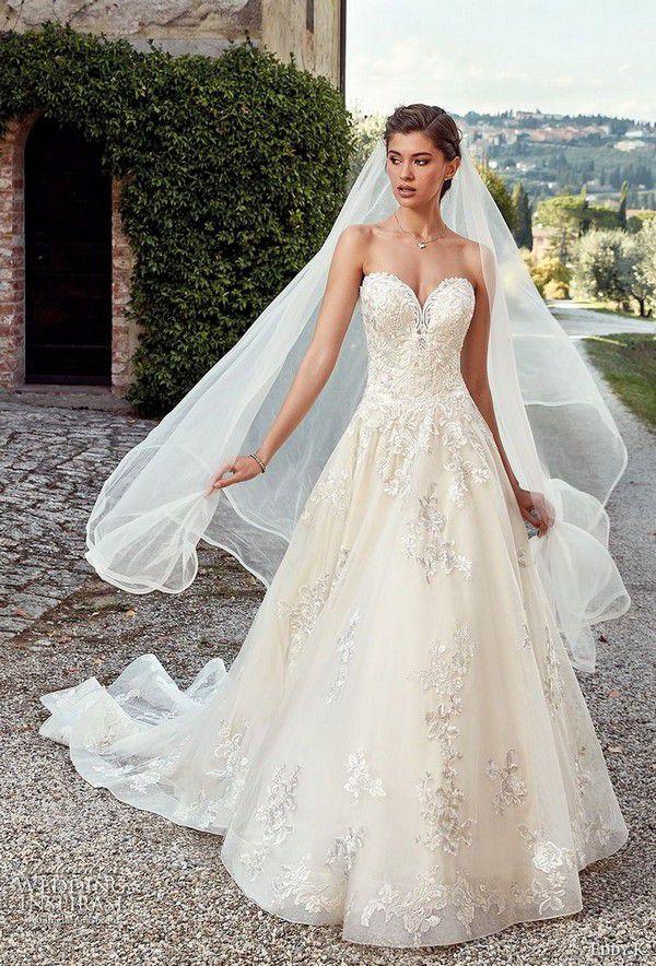 https://www.weddinginspirasi.com/wp-content/uploads/2018/04/eddy-k-2019-ek-strapless-sweetheart-neckline-heavily-embellished-bodice-romantic-ivory-a-line-wedding-dress-royal-train-38-mv.jpg