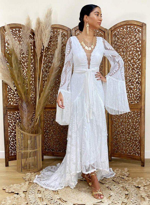 https://i0.wp.com/offbeatbride.com/files/2021/01/wedding-dresses-tassel-lace-wedding-dress-by-bibiluxe-on-offbeat-bride.jpg?resize=800%2C1095&ssl=1