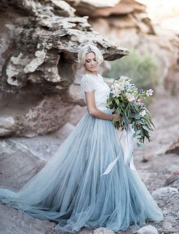 https://www.wedding-venues.co.uk/sites/default/files/blue-wedding-dresses-TylerReyPhotography.jpg