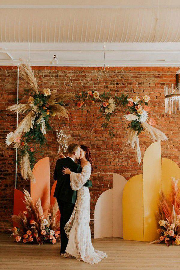 https://www.elegantweddinginvites.com/wedding-blog/wp-content/uploads/2020/11/modern-boho-orange-color-wedding-backdrops-683x1024.jpg
