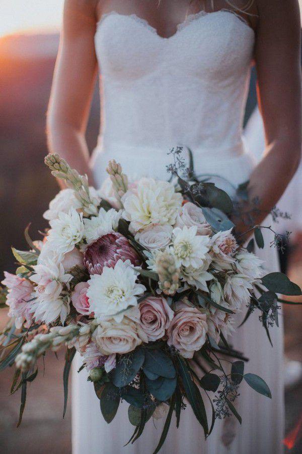 https://www.elegantweddinginvites.com/wedding-blog/wp-content/uploads/2018/07/stylish-blush-and-cream-floral-bridal-bouquet-683x1024.jpg
