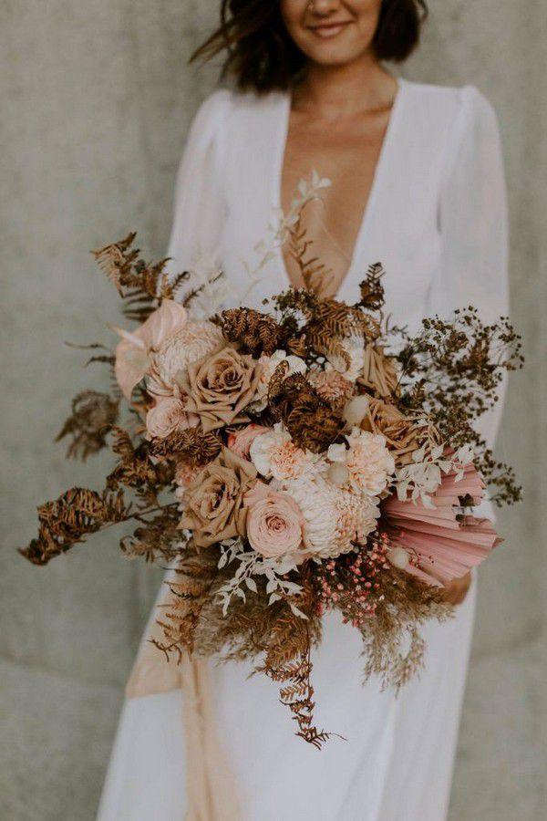 https://www.elegantweddinginvites.com/wedding-blog/wp-content/uploads/2020/08/cool-contemporary-blush-floral-wedding-bouquet-with-dried-leaves-683x1024.jpg