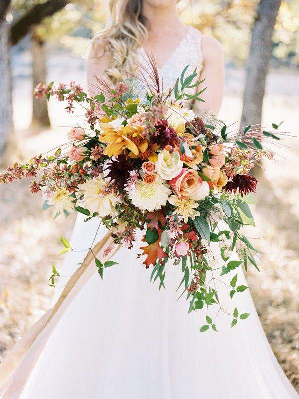 https://www.elegantweddinginvites.com/wedding-blog/wp-content/uploads/2018/07/stunning-wild-boho-style-rustic-fall-wedding-bouquets.jpg