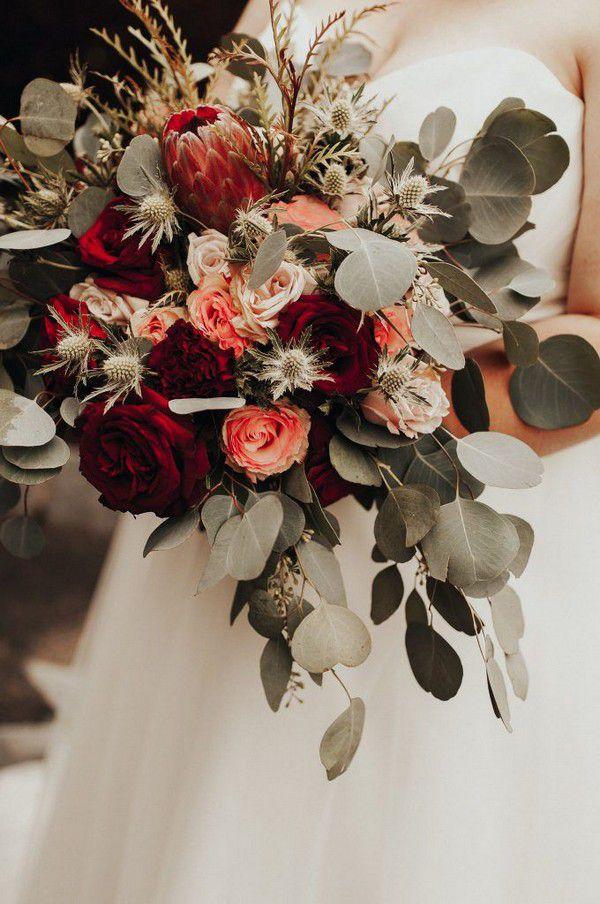 https://www.elegantweddinginvites.com/wedding-blog/wp-content/uploads/2020/08/bold-red-rose-and-protea-fall-wedding-bouquets-680x1024.jpg