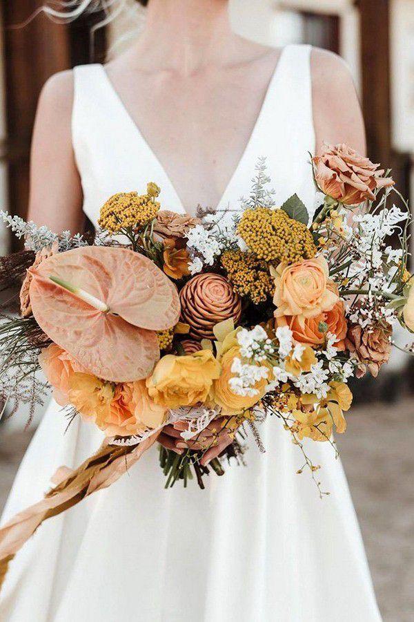 https://www.elegantweddinginvites.com/wedding-blog/wp-content/uploads/2020/08/modern-yellow-and-orange-elopement-bridal-bouquets.jpg