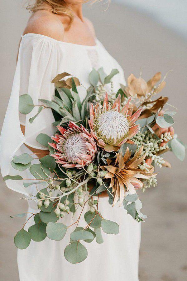 https://www.elegantweddinginvites.com/wedding-blog/wp-content/uploads/2018/07/tropical-fall-wedding-bridal-bouquets-684x1024.jpg