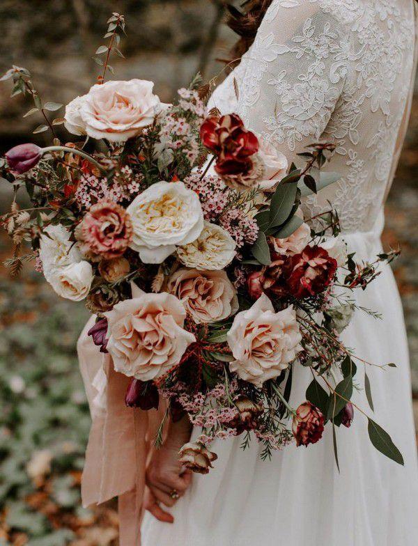 https://www.elegantweddinginvites.com/wedding-blog/wp-content/uploads/2020/08/blush-and-red-garden-rose-september-vinatge-bridal-bouquet-768x1004.jpg