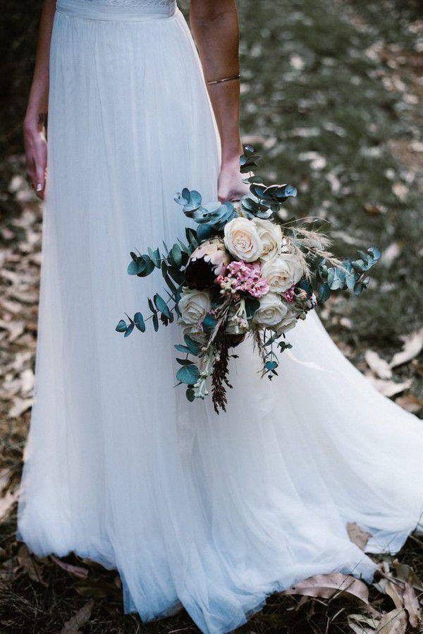 https://www.elegantweddinginvites.com/wedding-blog/wp-content/uploads/2018/07/dusty-blue-Eucalyptusvand-cream-white-flower-fall-wedding-bouquets-684x1024.jpg