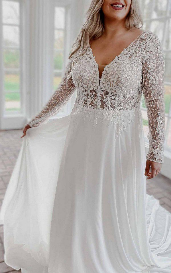 https://www.kleinfeldbridal.com/wp-content/uploads/2020/12/stella-york-modern-mixed-fabric-wedding-dress-with-lace-and-long-sleeves-34328781-1129x1800.jpg