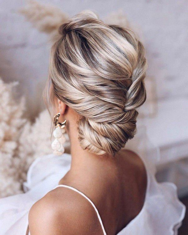http://www.loveinconfetti.com/wp-content/uploads/2020/07/twisted-updo-bridal-hairstyle.jpg