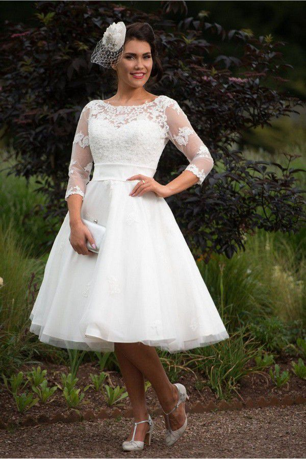 https://www.cuttingedgebrides.com/images/timeless-chic-polly-tea-length-vintage-1950s-style-wedding-dress-sleeves-p123-1430_image.jpg