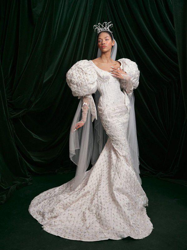 https://fashionista.com/.image/c_limit%2Ccs_srgb%2Cfl_progressive%2Ch_2000%2Cq_auto:good%2Cw_2000/MTgwMjA1MjQ3OTcxNTk5NDgy/wiederhoeft-bridal-spring-2022-wedding-dress-puff-sleeve.jpg