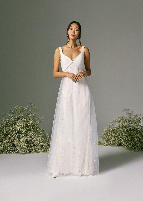 https://fashionista.com/.image/c_limit%2Ccs_srgb%2Cfl_progressive%2Ch_2000%2Cq_auto:good%2Cw_2000/MTgwMjIyNDgxMjU5MzA4Mzc2/savannah-miller-spring-2022-bridal-wedding-dress-sofia_sm8103_ss22_006.jpg