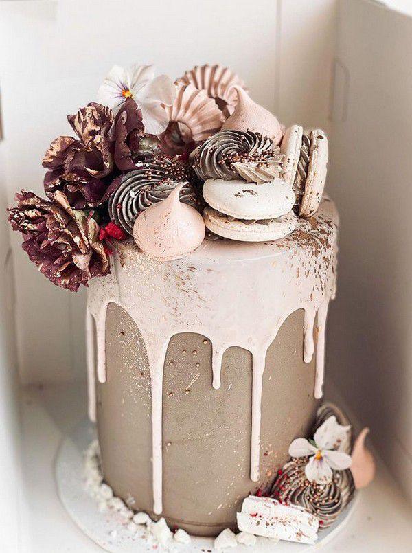 https://www.elegantweddinginvites.com/wedding-blog/wp-content/uploads/2020/09/nimi-flower-and-macaron-decotaed-dripping-wedding-cake.jpg