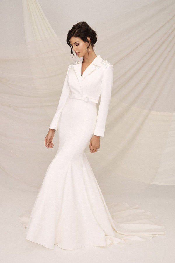 https://cdn0.hitched.co.uk/articles/images/3/8/5/4/img_64583/winter-wedding-dresses-justin-alexander-signature-ab2a3cd-scaled.jpg