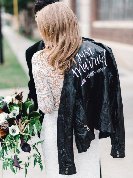 https://i.weddingomania.com/2018/12/05-a-black-leather-jacket-is-a-fashionable-piece-to-cover-up-with-this-trend-is-here-to-stay.jpg