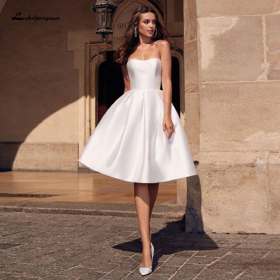 https://ae01.alicdn.com/kf/H2bc6f4066a754ac7941e6e9781721859u/Lakshmigown-Robe-Satin-Short-Wedding-Dress-2020-Hochzeit-Party-Gowns-Strapless-Sexy-Bridal-Dresses-with-Pockets.jpg
