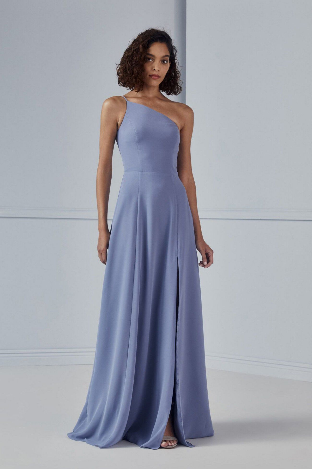 https://www.bridalreflections.com/wp-content/uploads/2020/09/Bridesmaids-CHIARA-GB159F-One-shoulder-Circle-skirt-Side-slit-Flat-Chiffon-Front-1333x2000.jpg