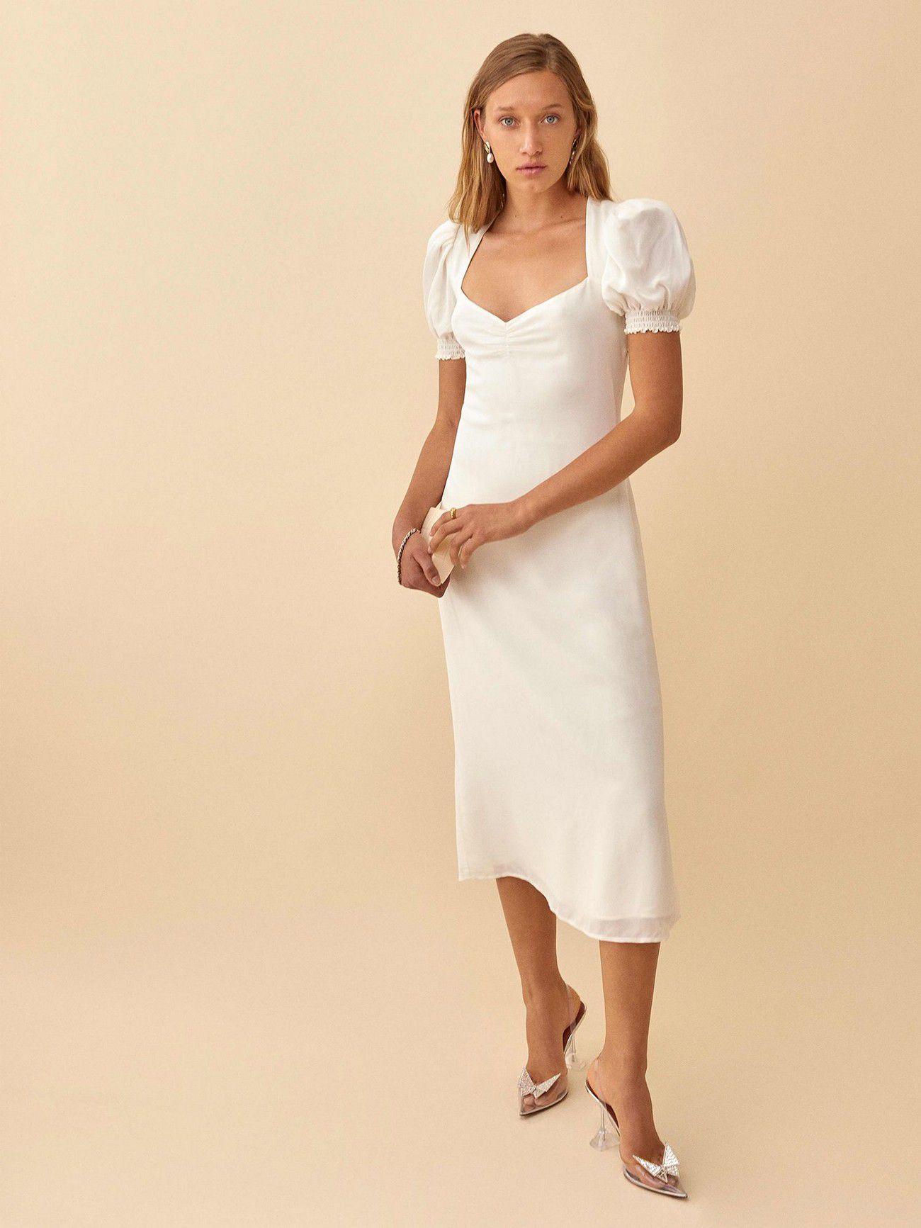 https://greenweddingshoes.com/wp-content/uploads/2020/09/luciana-reformation-short-wedding-dress.jpeg