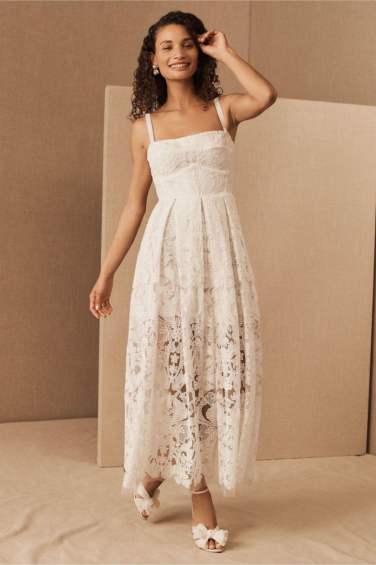 https://greenweddingshoes.com/wp-content/uploads/2020/09/lace-short-wedding-dress.jpeg