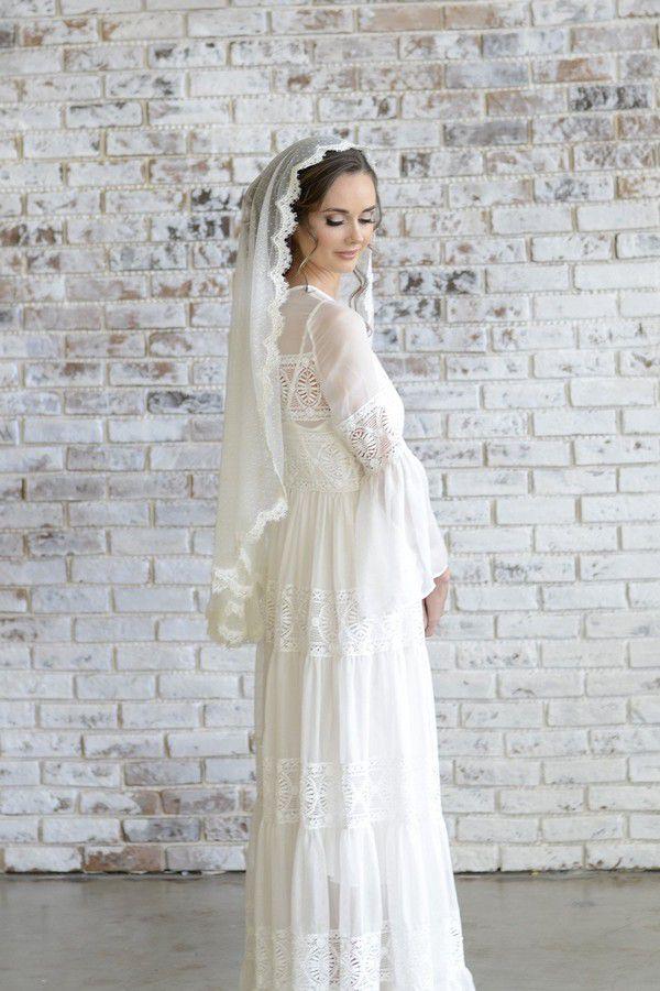 https://cdn.shopify.com/s/files/1/0883/0956/products/Freya-lace-mantilla-veil-lace-veil-wedding-madame-tulle-fingertip-length_AGE6297_2000x.jpg?v=1569229711